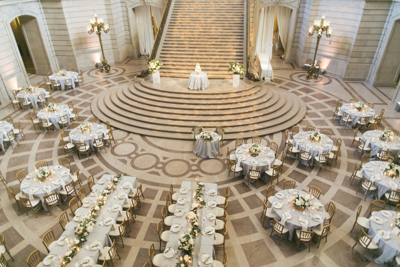 The Elegant Reception With Soft Blue Linens And Gold Versailles Chairs